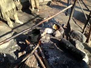 Making dinner the old fashioned way - on an open fire.  At Plimouth Plantation.