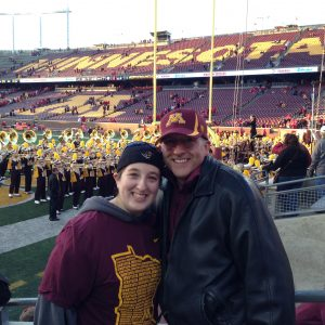 Dad and daughter at the UMN game - the Boomer alum and the student