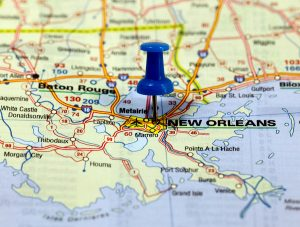 Should she choose to return to New Orleans, where family roots and history are strong?