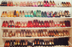 photo filled with pairs of shoes stacked on shelves