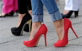 great photo of woman walking in super high red stiletto shoes - ready for shopping in retirement