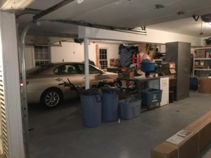 photo of our garage with a car in it