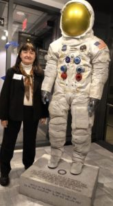 Volunteering in retirement. Pat stands next to a full-sized space suit