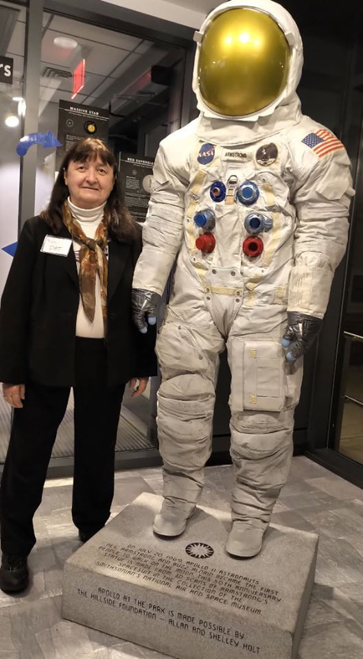 Pat next to life-sized space suit