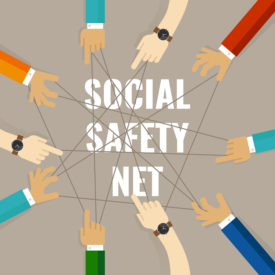 Image of hands all connected by string representing a social safety net